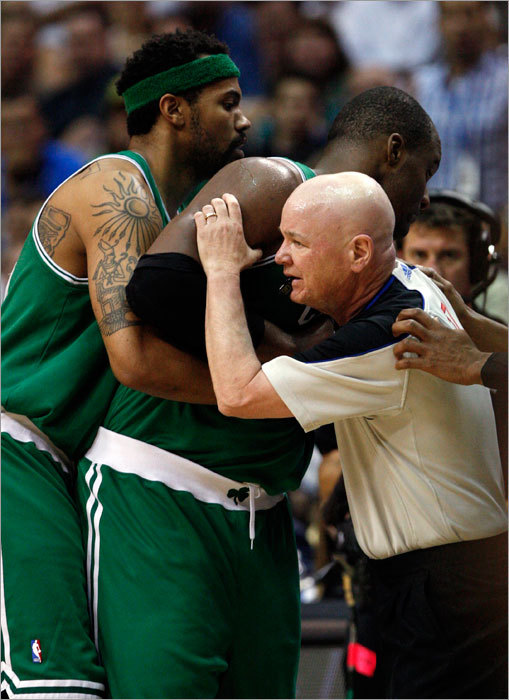 Rasheed Wallace (left) and referee Joey Crawford prevented Glen Davis from falling to the floor, and instead helped him sit down to receive medical attention..