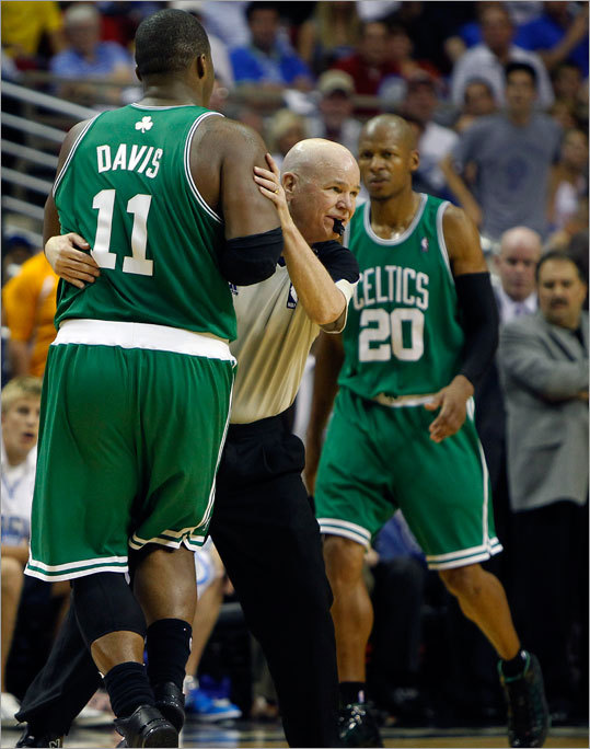 Referee Joey Crawford held up Celtics forward Glen Davis after Davis became disoriented after he took an elbow to the head from the Magic's Dwight Howard. Davis was diagnosed with a concussion and did not return to the Game 5 of the Eastern Conference finals in Orlando, Fla. The Magic defeated the Celtics and forced a Game 6 on Friday in Boston.