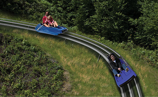 Attitash Mountain Coaster , Bartlett, N.H. Taking a cue from its incumbent Alpine slide and putting a new twist on the concept, Attitash Mountain Resort introduces a new roller coaster-type attraction this summer. The Mountain Coaster will take riders on a 2,880-foot journey before dropping 316 vertical feet at rider-controlled speeds up to 25 miles per hour. As single ride will run you $15, but the better deal is to hit up the mountain in the evening, when the ride is yours from 6-8 p.m. for $20.