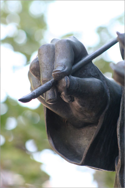 Alhadi recommends detail shots of statues, such as this close-up of the right hand of the statue of John Singleton Copley in Copley Square.