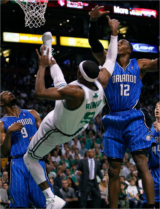 Celtics guard Rajon Rondo was injured after being fouled by the Magic's Dwight Howard and tumbling to the floor in the first half.