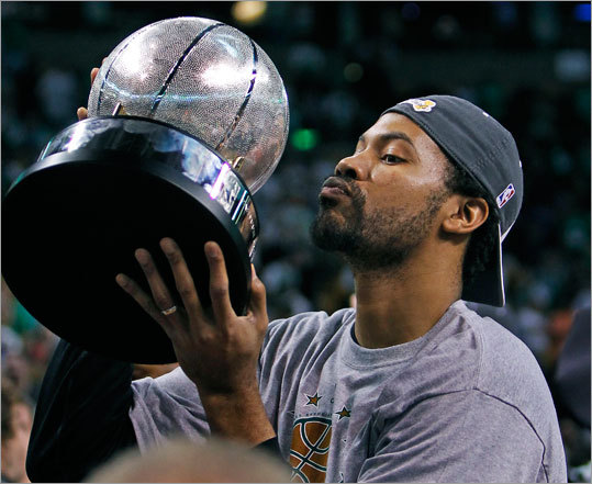 The Celtics' Rasheed Wallace hoisted the Eastern Conference championship trophy after the Celtics defeated the Magic 96-84 Friday night in Game 6 of the Eastern Conference finals series at TD Garden. The Celtics advanced to the NBA Finals, where they will face the Lakers or the Suns.