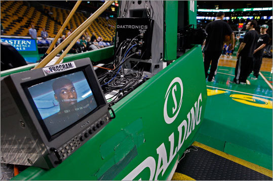 The Celtics Kendrick Perkins was shown on a video monitor behind a basket as he did a pregame interview while other players shot around on the floor about two hours before the game.