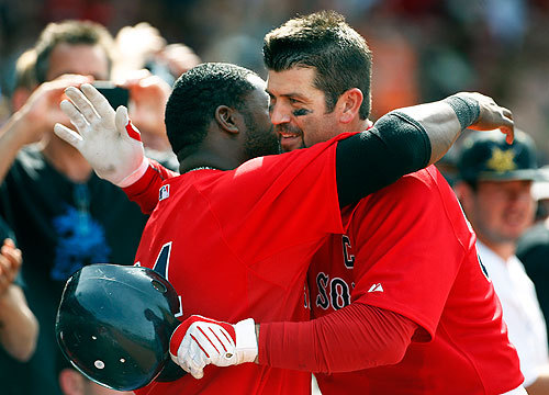 David Ortiz and Jason Varitek celebrated their home runs today with a hug, this coming after Varitek's that closed out the scoring in the 8-1 victory.