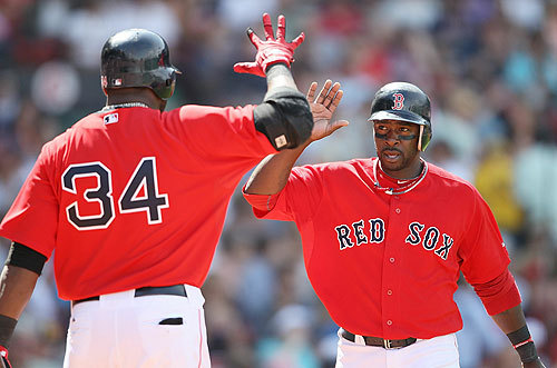 David Ortiz greeted Bill Hall after Hall scored in the fifth. Ortiz followed with his home run.