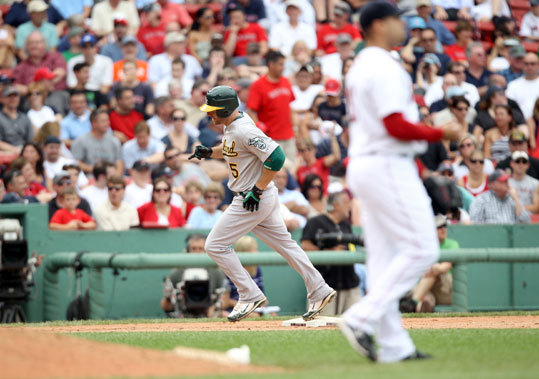 Kevin Kouzmanoff of the Athletics rounds third base after hitting a home run off Red Sox reliever Manny Delcarmen in the eighth inning. Delcarman gave up a homer to A's DH Jack Cust before facing Kouzmanoff.