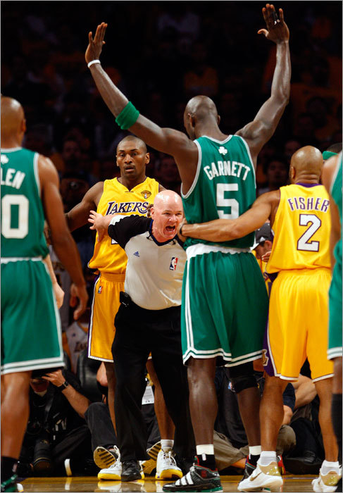 Referee Joe Crawford got between Celtics forward Kevin Garnett (5) and Lakers forward Ron Artest after a first-quarter clash under the basket.