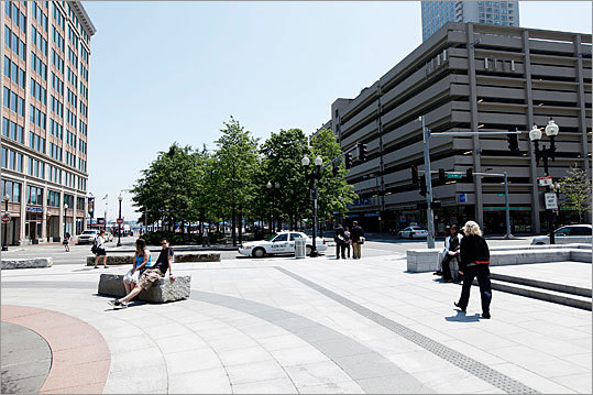 Chiofaro's vision for the area around Harbor Garage (right), unveiled earlier this year, involves redesigning the New England Aquarium's property. The plan was part of his proposed development on the Boston waterfront, where he wants to relocate the IMAX theater into an atrium at the base of a massive office, residential, and retail complex.