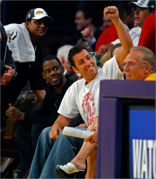 Actors Chris Rock and Adam Sandler sat together at courtside and interacted with other fans at the Staples Center.