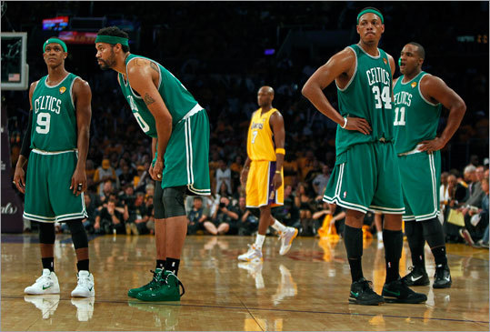 The Celtics' Rajon Rondo, Rasheed Wallace, Paul Pierce and Glen Davis (left to right) showed their dejection as a Laker shoots a free throw after Wallace was called for a second-half technical foul.