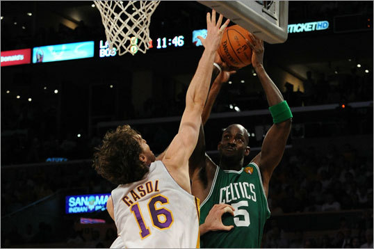 Celtics forward Kevin Garnett got a turnaround jumper up over Pau Gasol.