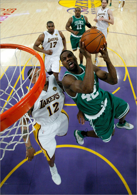 Tony Allen went to the basket against Shannon Brown of Los Angeles.
