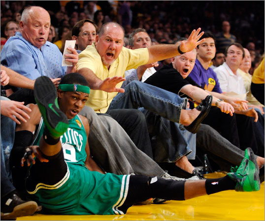 Celtics guard Rajon Rondo found himself in the first row in the second half.