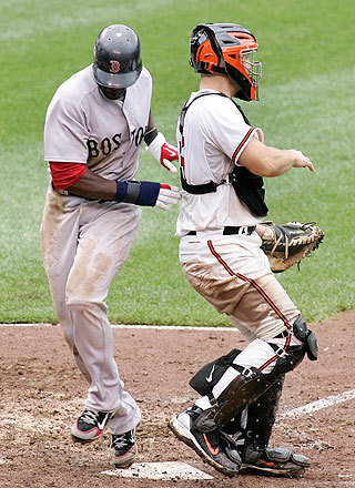 Mike Cameron ran into Orioles catcher Craig Tatum while scoring the tying run in the ninth inning on Dustin Pedroia's sacrifice fly. The Orioles had take a 3-2 lead in the bottom of the eighth.