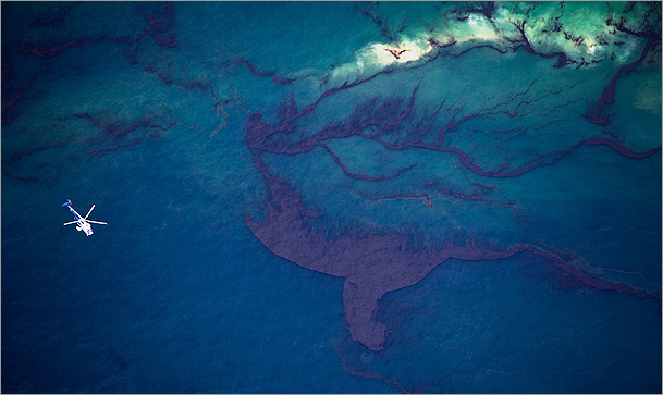 A helicopter flew over surface oil in the Gulf of Mexico on May 18, 2010.