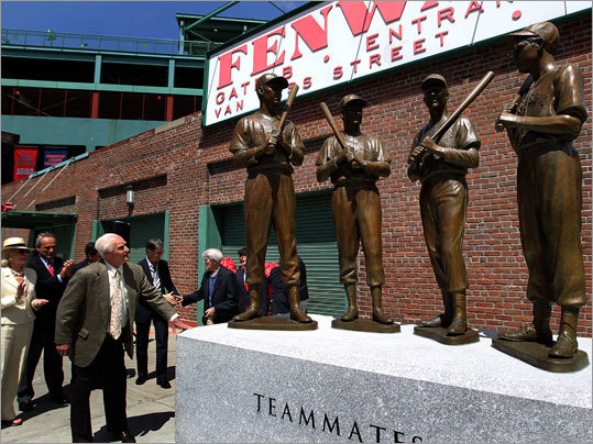 Red Sox legend Bobby Doerr admires 'Teammates,' a statue that was unveiled outside Fenway Park Wednesday to honor Doerr, Johnny Pesky, Dom DiMaggio and Ted Williams, who were fast friends during and after their time as Red Sox teammates. The statue was created by sculptor Antonio Tobias Mendez.