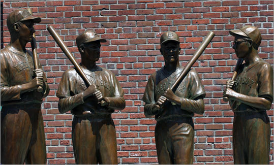 The statue, created by sculptor Antonio Tobias Mendez of Maryland, features the four teammates standing shoulder to shoulder holding baseball bats. The figures of all four players on the statue are depicted as they appeared in 1946, with similar uniform styles, caps and spikes.