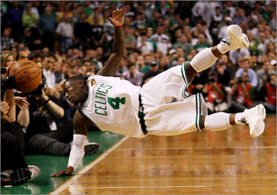 "Celtics guard Nate Robinson went all out for a loose ball in the fourth quarter. Robinson had 12 points. ""We just knew we had to bring our energy,"" Robinson said of the bench players who stepped up large in Game 4. ""That's the main thing for us, the more energy we bring, the better defensively we are, the better offensively we are."""