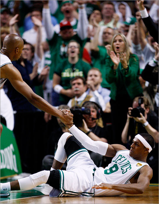 Celtics guard Rajon Rondo (right) was helped up by Ray Allen in the 4th quarter.