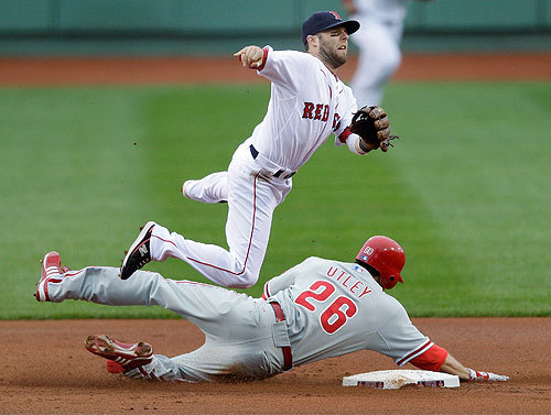 The Sox escaped a bases-loaded, none-out jam in the first as Tim Wakefield induced an inning-ending double play. Dustin Pedroia turned the DP over Chase Utley.