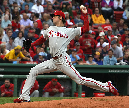 Left-hander Cole Hamels put the brakes on the Phillies' three-game skid by tossing seven effective innings.