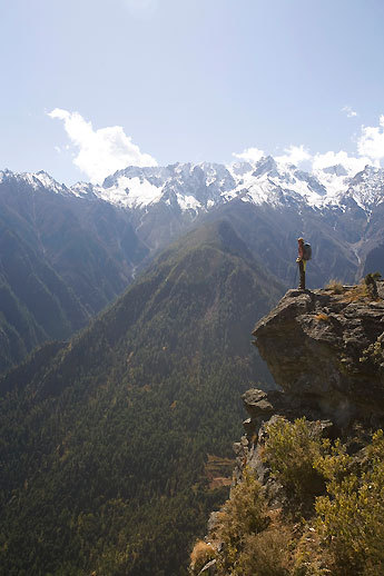 Trekker Sam Voolstra on an overlook of Nepal's Karnali River Valley on the first day of a trip on the Great Himalayan Trail, two hours from Simikot.