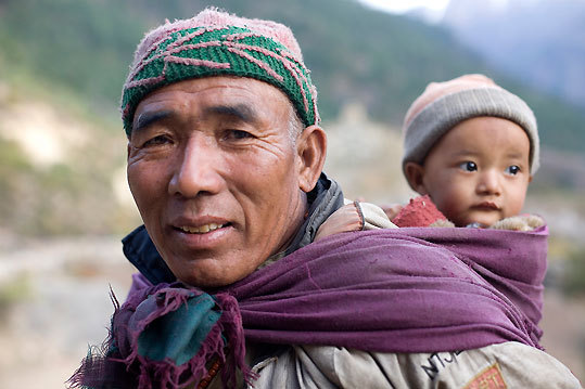 A local man carried his son in the Karnali River Valley west of Yalbang.
