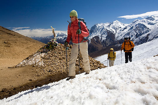 Trekkers Sam Voolstra, Jamie McGuinness, and Monica Oliveros crest the Nara Lagna at 15, 912 feet.