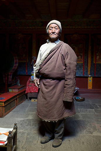 A village elder pauses near the shrine in his house in the village of Til in the Limi Valley on the ninth day of the trek.