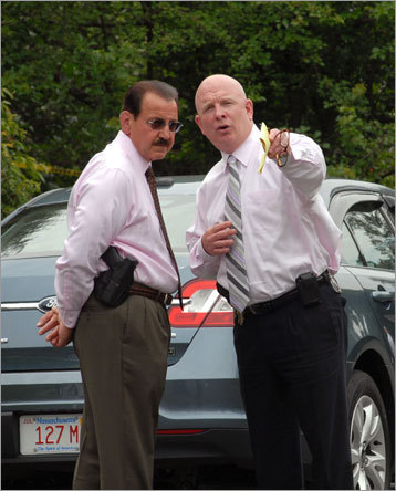 Winchester Police Chief Kenneth Albertelli, left, and a State Police detective talked at the scene.