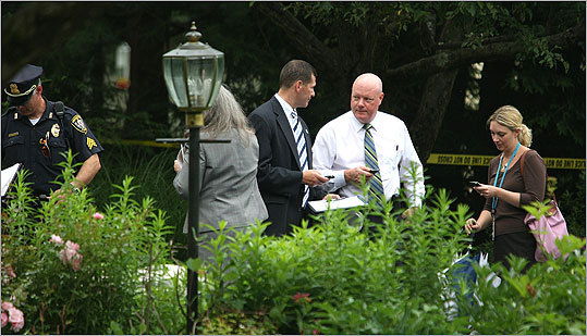 Officials with the Massachusetts State Police, Winchester police, and the office of Middlesex DA Gerard T. Leone Jr. (third from left) were conducting the investigation.