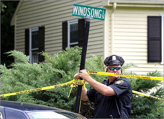 Mortimer's father, Thomas Mortimer III, said he last saw his son on June 13, 2010, when he came to Winchester to baby-sit for his grandchildren. Pictured: Winchester police Officer G.E. Rogers adjusted the police line tape.