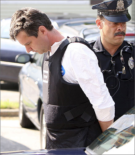Mortimer was led to court June 18, 2010, while wearing what appeared to be a bulletproof vest. He left written confessions in his Winchester home before fleeing.