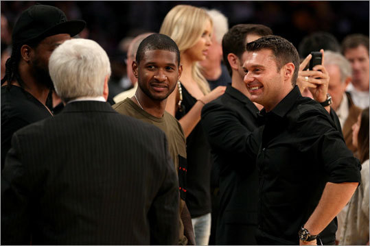 Musician Usher and television host Ryan Seacrest were on the court during halftime.