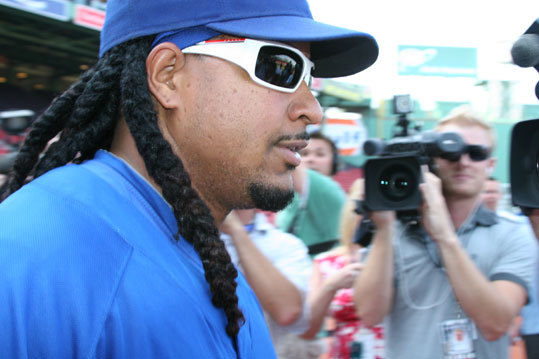 Manny made his way through the crush of media without saying a word on his way to the field.