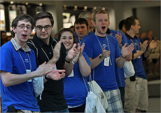 Apple employees cheered and clapped as customers entered the store on Boylston Street.