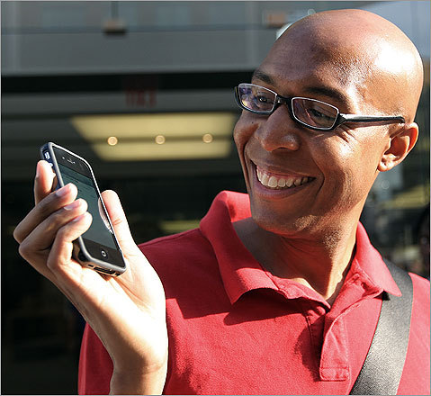 Simmons appeared quite happy with his new phone.