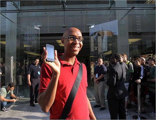 With his new phone, Korland Simmons of Jamica Plain stepped outside the store.