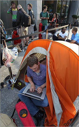 With his Apple laptop in hand, Rick Penwell of Boston sat in his tent as he waited in line. Penwell had been waiting in line since 5 p.m. yesterday.