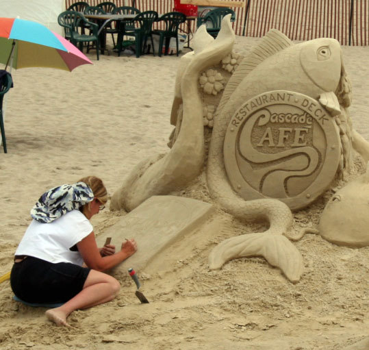 A sculptor put the finishing touches on a piece dedicated to a local Hampton Beach establishment.