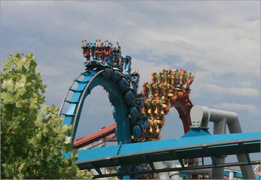 Visitors are turned upside-down on the Double Dragon ride.