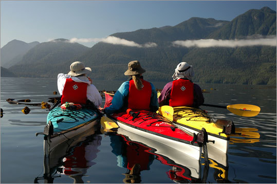 Kayakers pause in the Johnstone Strait.