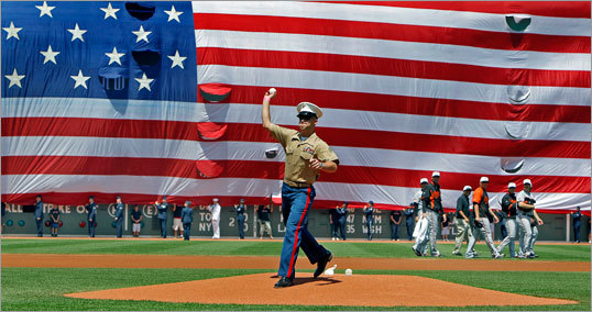 Sergeant Aaron Silton threw out the ceremonial first pitch before the game on July 4, 2010.