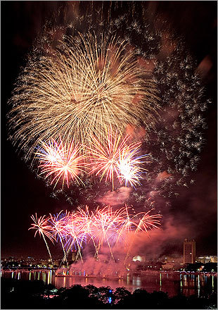 The pyrotechnics were shot from barges in the Charles River after Sunday night's Boston Pops concert.
