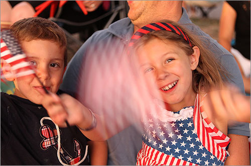 Creed Rollins, 3, and Georgia Rollins, 4, waved their flags during the concert.