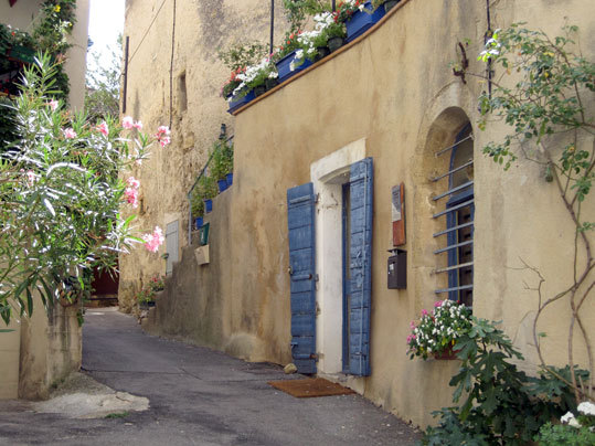 "A quiet side street in Lourmarin, designated as ""one of the most beautiful villages in France.''"