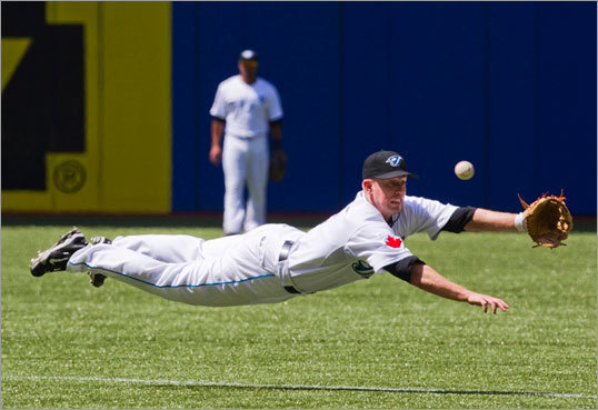 Toronto second baseman Aaron Hill dove but could not come up with a ball hit by Boston's Bill Hall in the seventh inning.