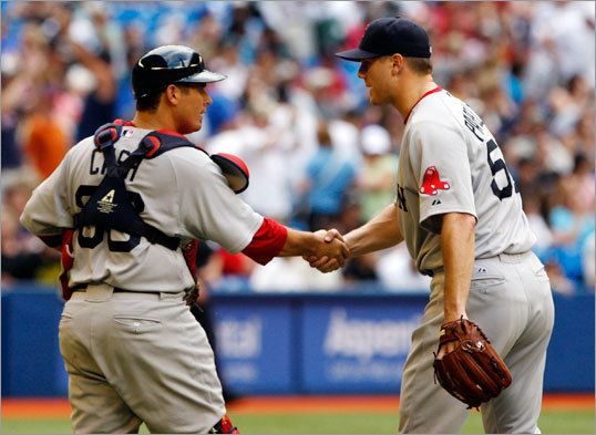 Kevin Cash (left) and Jonathan Papelbon celebrated Boston's win in the last game before the All-Star break.