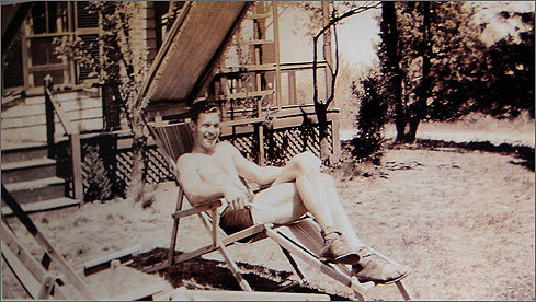 An old photo of James Currier's grandfather sitting in front of the cottage in 1931. Joseph Stephen Currier - James Currier's great-great-great grandfather - bought the house for $2,400 in 1876.