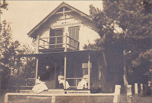 This photo of the cottage was taken around 1910. Using old photographs and the cottage next door as a guide, they eventually brought the place back to its original, salt-of-the-earth roots. Formica countertops were removed from the kitchen, white plasterboard was taken off the walls, and cedar shingles that covered the exterior of the house came down. Ornate gingerbread trim was restored along the roof, and vintage plumbing fixtures were installed.